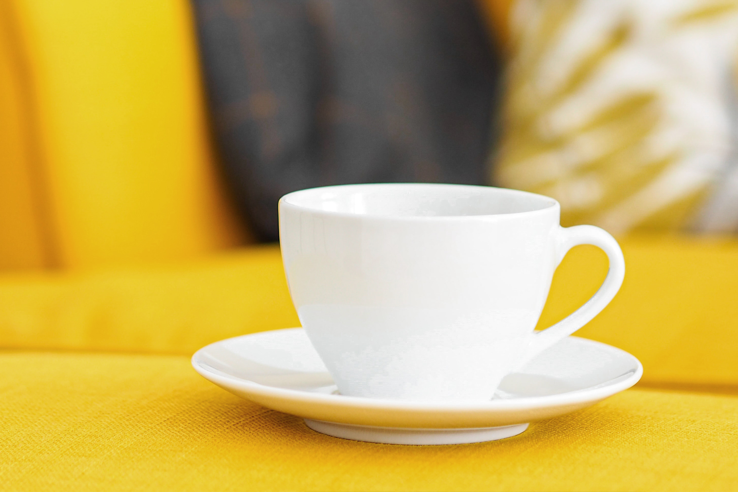 white coffee cup on yellow background