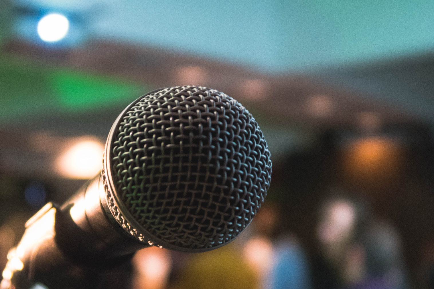 microphone in front of blurred background with people